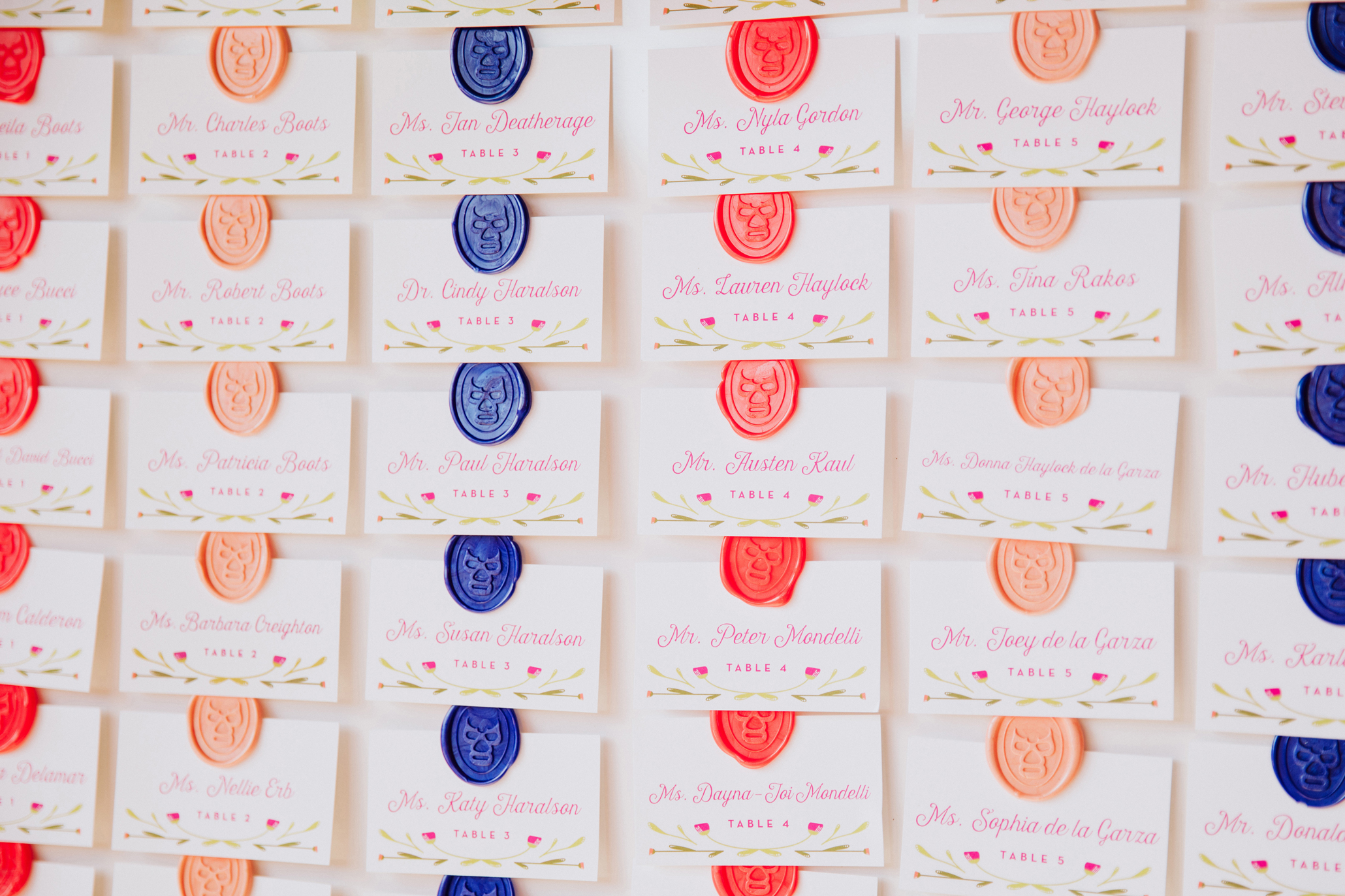 wax seal escort card chart, with fun bright colors